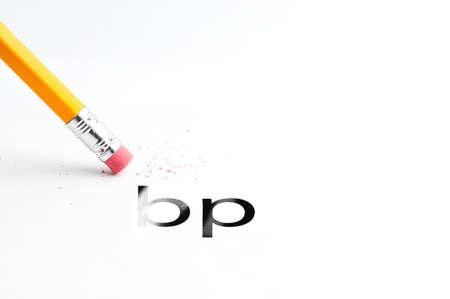 bp: Closeup of pencil eraser and black bp text. Bp. Pencil with eraser.