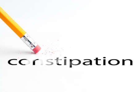 cleanse: Closeup of pencil eraser and black constipation text. Constipation. Pencil with eraser.