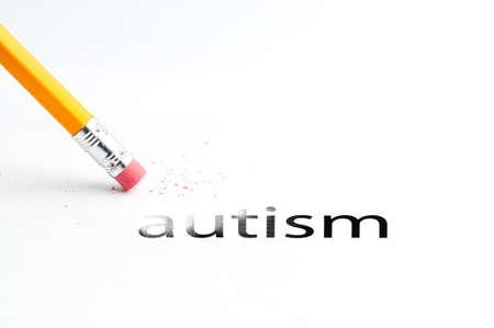 asperger: Closeup of pencil eraser and black autism text. Autism. Pencil with eraser. Stock Photo