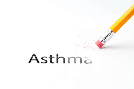 Closeup of pencil eraser and black asthma text. Asthma. Pencil with eraser.