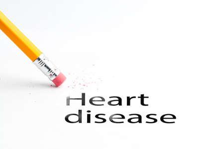 presure: Closeup of pencil eraser and black heart disease text. Heart disease. Pencil with eraser. Stock Photo