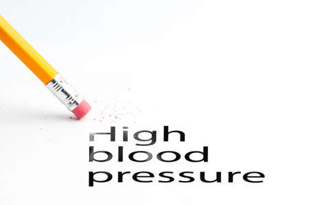 incontinence: Closeup of pencil eraser and black high blood pressure text. High blood pressure. Pencil with eraser. Stock Photo