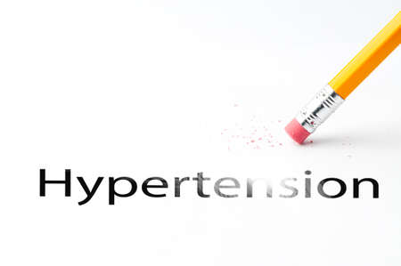 eradicate: Closeup of pencil eraser and black hypertension text. Hypertension. Pencil with eraser.