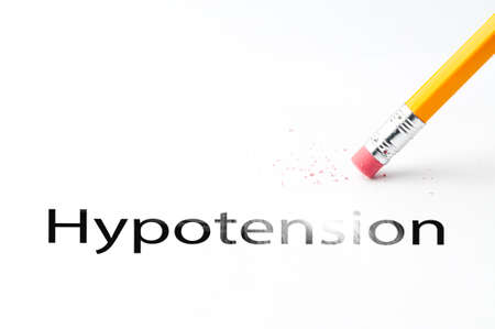 incontinence: Closeup of pencil eraser and black hypotension text. Hypotension. Pencil with eraser. Stock Photo