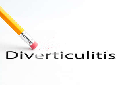 ulcerative: Closeup of pencil eraser and black diverticulitis text. Diverticulitis. Pencil with eraser. Stock Photo