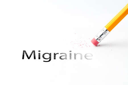 eradicate: Closeup of pencil eraser and black migraine text. Migraine. Pencil with eraser.