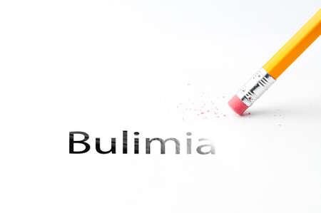 bulimia: Closeup of pencil eraser and black bulimia text. Bulimia. Pencil with eraser.