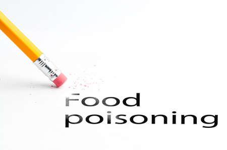 food poisoning: Closeup of pencil eraser and black food poisoning text. Food poisoning. Pencil with eraser.