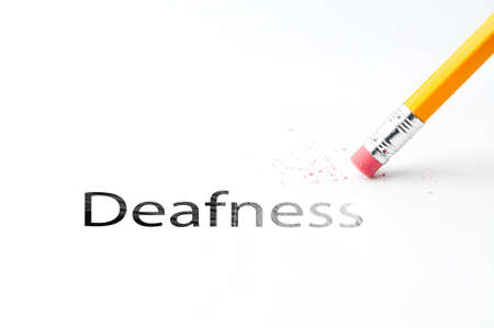 cochlear: Closeup of pencil eraser and black deafness text. Deafness. Pencil with eraser.