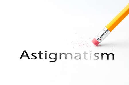 astigmatism: Closeup of pencil eraser and black astigmatism text. Astigmatism. Pencil with eraser.