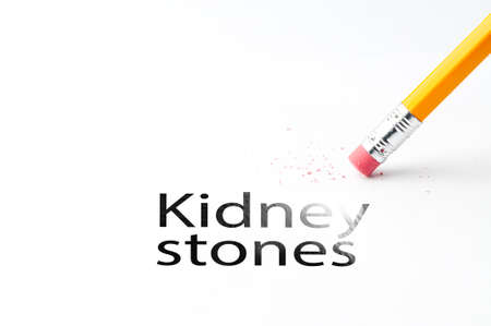 Closeup of pencil eraser and black kidney stones text. Kidney stones. Pencil with eraser.