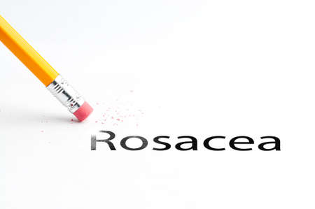 Closeup of pencil eraser and black rosacea text. Rosacea. Pencil with eraser. Stock Photo