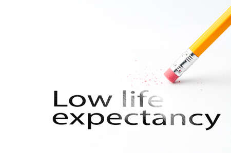 expectancy: Closeup of pencil eraser and black low life expectancy text. Low life expectancy. Pencil with eraser.