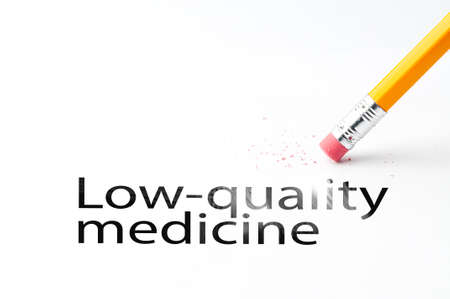 Closeup of pencil eraser and black low-quality medicine text. Low-quality medicine. Pencil with eraser.