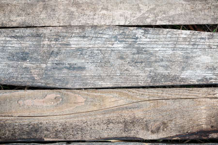 lain: Old cracked board long lain outdoors.Old board.Background of wood.