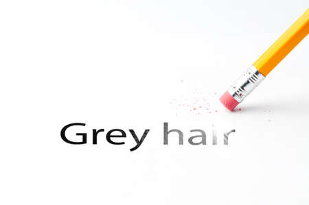 grizzle: Closeup of pencil eraser and black grey hair text. Grey hair. Pencil with eraser.