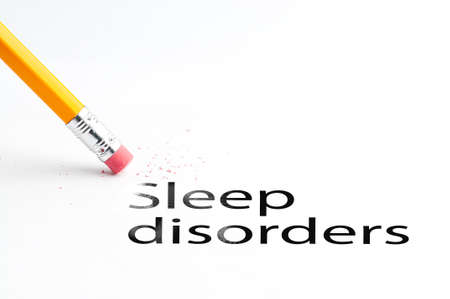 eradicate: Closeup of pencil eraser and black sleep disorders text. Sleep disorders. Old people disease. Pencil with eraser.