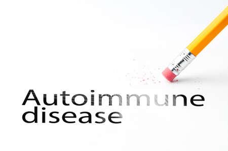 Closeup of pencil eraser and black autoimmune disease text. Autoimmune disease. Pencil with eraser.