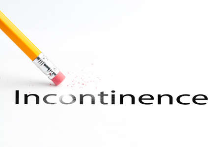 continence: Closeup of pencil eraser and black incontinence text. Incontinence. Pencil with eraser. Stock Photo