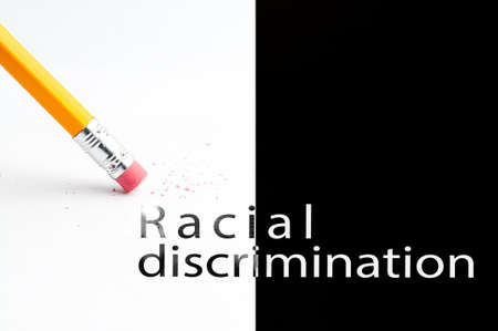 racial: Closeup of pencil eraser and black racial discrimination text. Racial discrimination. Pencil with eraser. Stock Photo