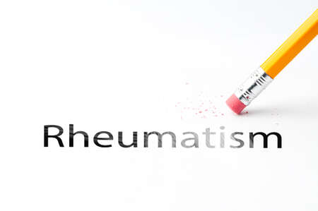 rheumatism: Closeup of pencil eraser and black rheumatism text. Rheumatism. Pencil with eraser. Stock Photo