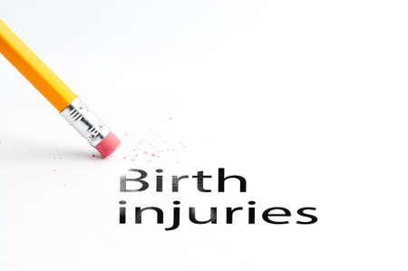 cerebral palsy: Closeup of pencil eraser and black birth injuries text. Birth injuries. Pencil with eraser.