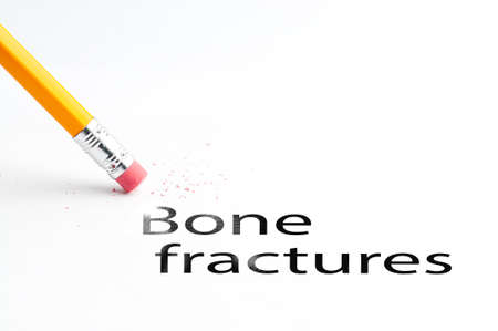 musculoskeletal: Closeup of pencil eraser and black bone fractures text. Bone fractures. Pencil with eraser.