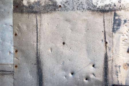 nailed: Background of old metal sheets. Metal sheets nailed.