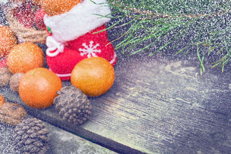 Christmas decorations lay in a wicker basket. Merry Christmas. Christmas background. Christmas Socks. 2017 year. Christmas decorations. New Year background. Xmax background. Toned image. Snow falls.