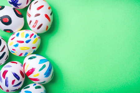 Easter eggs in a green background