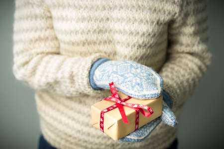 A girl holding a box with a Christmas present Stock Photo