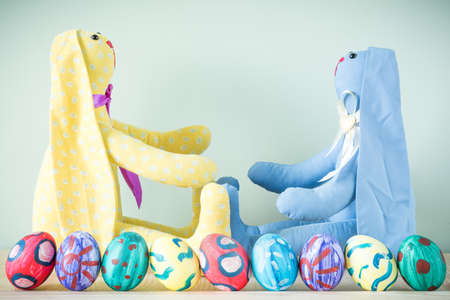 Two easter bunnies on a wooden table