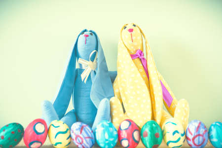 Easter bunnies on a green background Stock Photo