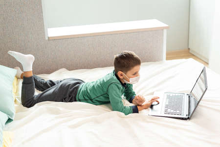 Stay at home quarantine coronavirus pandemic prevention. A child learns online on a laptop during quarantine. Distance learning. Prevention epidemic. COVID-19.
