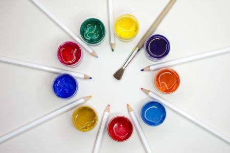 Hobby. Paints, brushes, pencils. White background