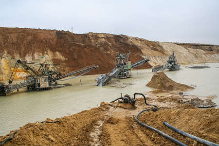dragline: Clay quarry near the town of Pology in the Zaporizhya region of Ukraine flooded heavy rains. Equipment for mining of refractory clay -excavator rotary electric electric. March 2006