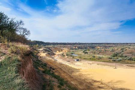 powe: Sand quarry near the town of Orikhiv in Zaporizhzhia region of Ukraine. Excavator caterpillar electric power shovel EKG 4,6, with bucket capacity of five cubic meters. September 2006 Stock Photo