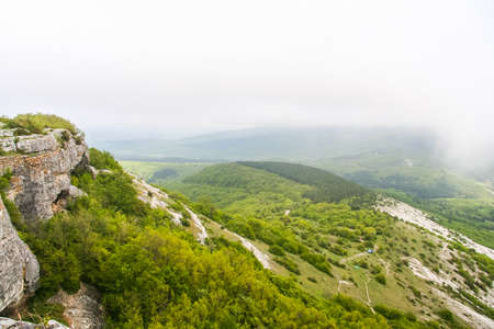 The ruins of the fortress Mangpp (Mangup-Kale, Crimean-Tat. Mangup, Mangup) - a medieval fortress city in the Bakhchsarai district of the Crimea. The historical name is Baba-Dag, Father-Mountain. The capital of the principality Theodoro (Crimean Gothia),  Stock Photo
