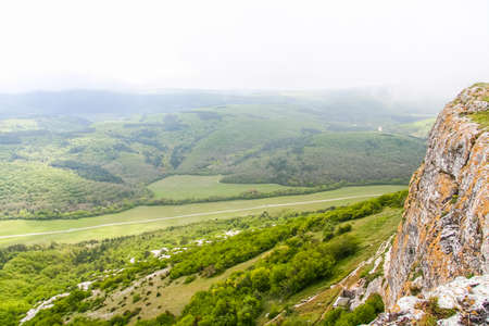 The vicinities of the Mangush Plateau (Baba-kaya Mountain) near the village of Khodja Sala of Bakhchisaraysky District. Crimea, Ukraine. MAY 2009 Stock Photo