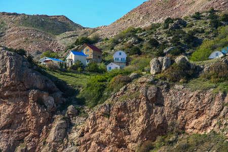 Dacha settlement near the dumps of the quarry of the Balaklava Mining Department. Balaklava, Crimea, Ukraine. Stock Photo