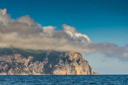Cape Aya is a steep spur of the Main Ridge of the Crimean Mountains near the village of Balaklava. Crimea, Ukraine. May 2009 Фото со стока