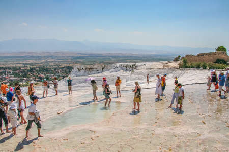 bicarbonate: Travertine (Tiburian stone) - calcareous tuff, polycrystalline, brittle fine-grained, homogeneous rock formed by calcium carbonate minerals (mainly aragonite with a smaller fraction of calcite), calcareous deposits of carbonic sources in Pamukkale. Turkey