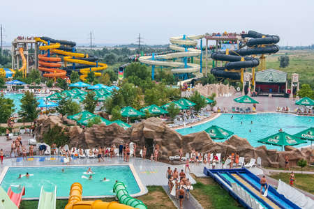 Water attractions in the water park of the city of Berdyansk. Zaporozhye region, Ukraine. August 2009