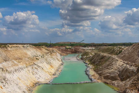 groundwater: Clay quarry near the town of Pogohy in the Zaporozhye region. Ukraine. August 2009 Stock Photo