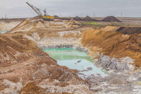 A powerful dragline excavator works in a clay quarry in the Zaporozhye region of Ukraine