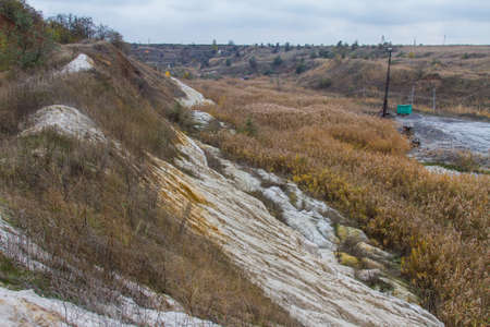 A powerful dragline excavator works in a clay quarry in the Zaporozhye region of Ukraine. November 2017 Reklamní fotografie