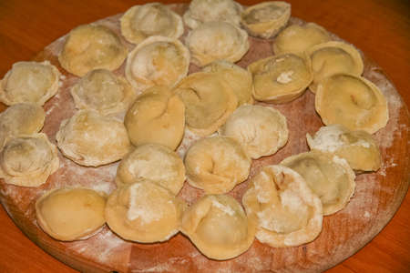 Pelmeni - Ukrainian version of Chinese dish Momo - dish from dough with meat stuffing. Stock Photo