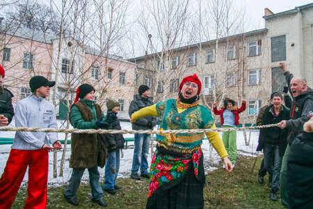 Folk festivities for carnival. Tug of war. Zaporozhye region, Ukraine. March 2011