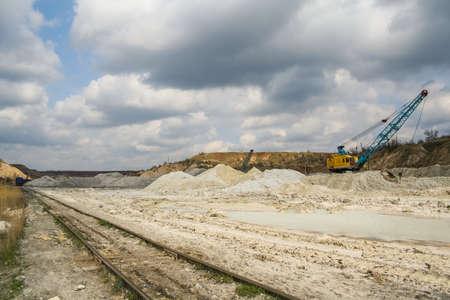 Rotary excavator in kaolin quarry. Zaporozhye region, Ukraine. November 2012