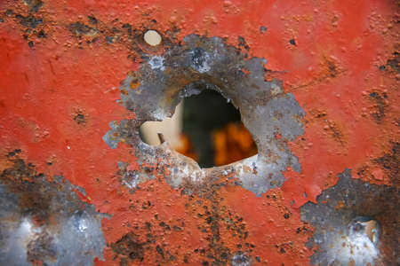 Hole from the canister of the twelfth caliber of a hunting smooth-bore gun in a steel plate 3 mm thick 版權商用圖片